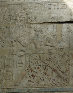 Heb-sed scene of Amenhotep III from Luxor Temple.  The three markers can be seen just behind the king under his rear forearm.