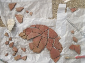 Bowl fragments being reassembled