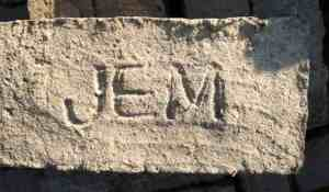 Modern unbaked mud brick stamped with the logo of the Joint Expedition to Malqata