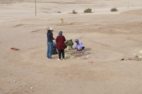 Janice and Mrs. Amal discussing pottery finds from the West Settlement