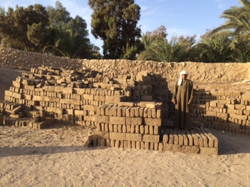 Stacks of new mud bricks. This is a stack of about 3,000 bricks. Can you imagine what a stack of approximately 400 times more bricks would look like?